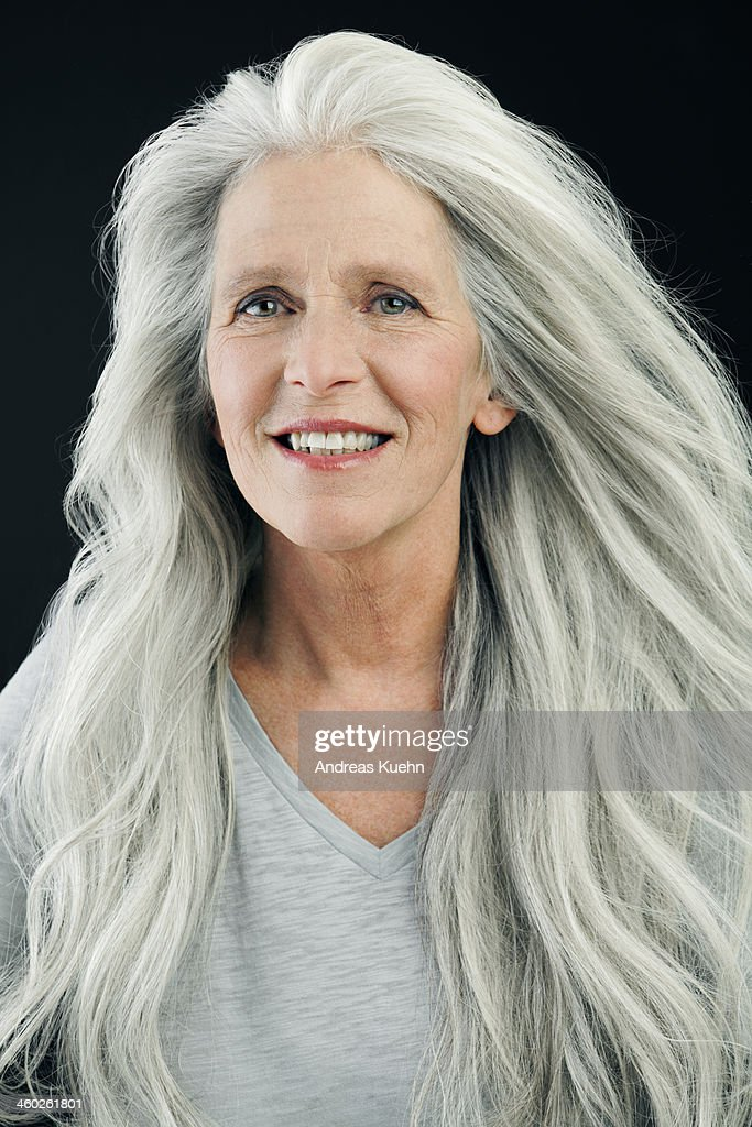 mature woman with wind blown long