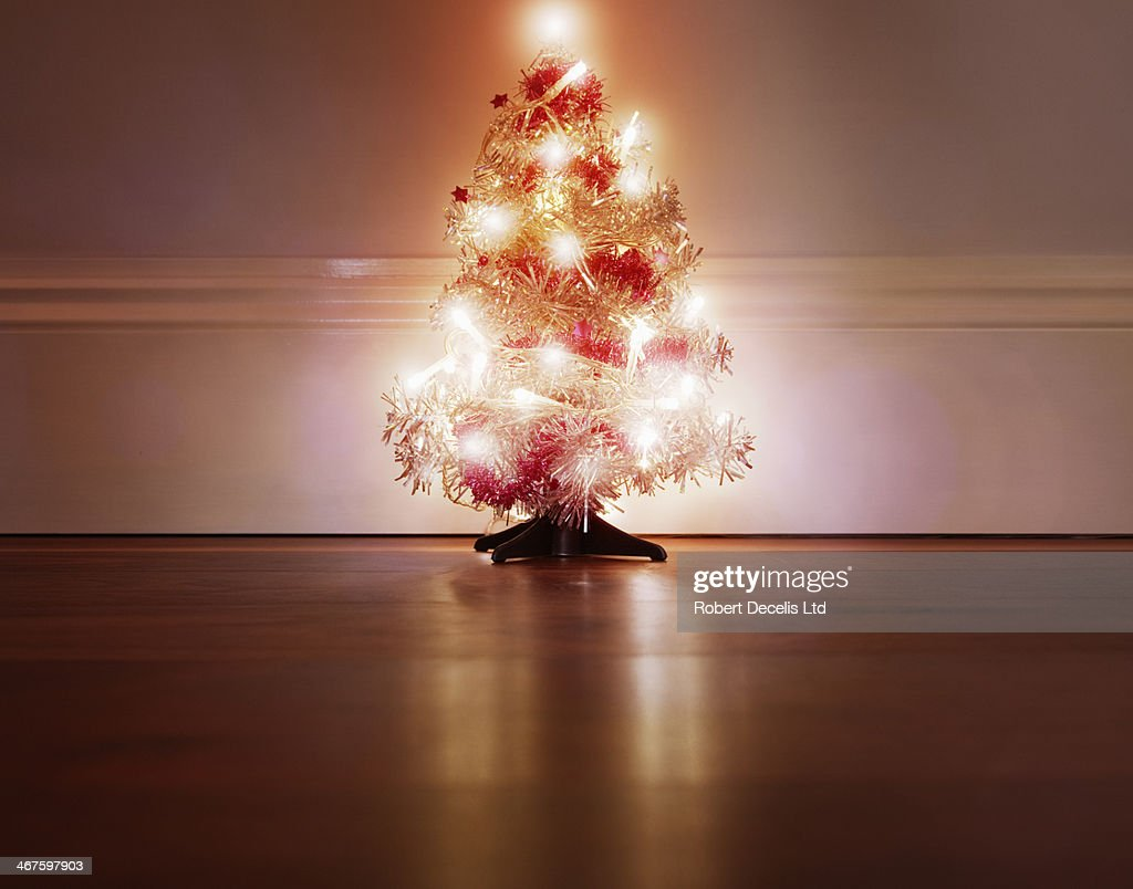 Close Up On Christmas Tree And Stocking Hanging On Fireplace Stock Christmas Tree Stock Photos And Pictures | Getty Images