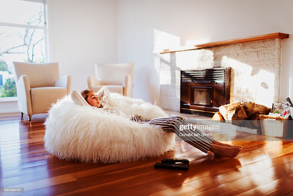 living room bean bags modern home decor ideas for bag stock photos and pictures mixed race girl relaxing in beanbag chair