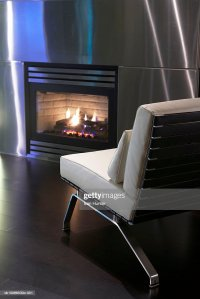 Modern Leather Chair Next To Stainless Steel Fireplace ...