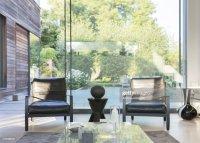Modern Living Room Overlooking Swimming Pool Stock Photo ...