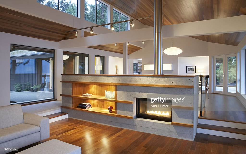 Modern Living Room With Chimney Stock Photo