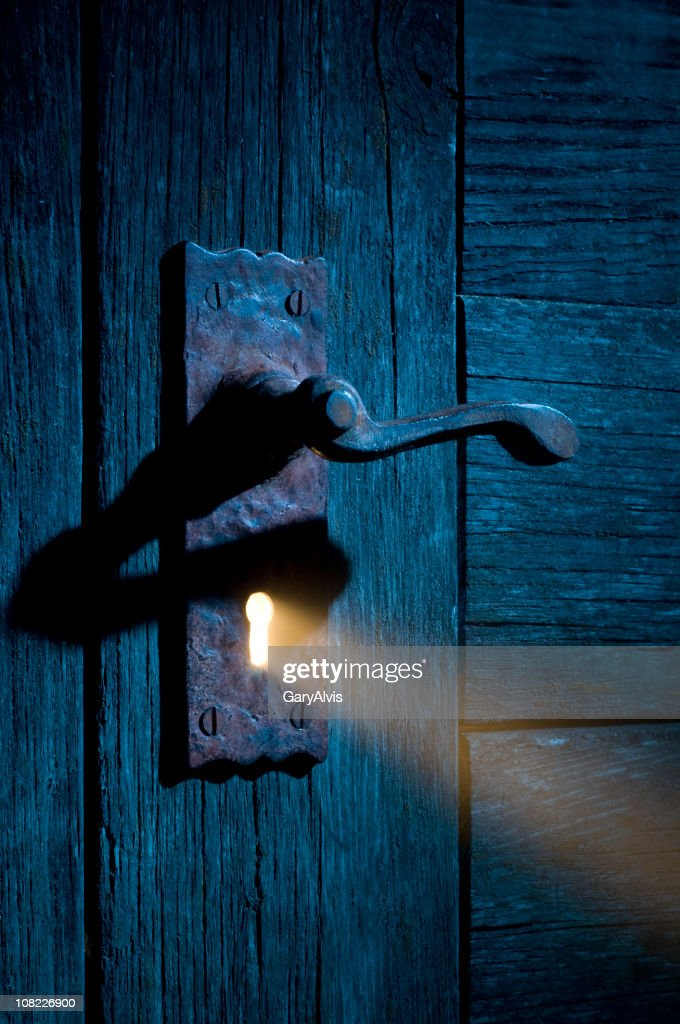 Mysterious Light Coming Through Antique Keyhole And Door