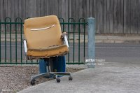 Old Abandoned Chair On Footpath Against Street Stock Photo ...