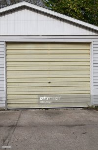 Old Fiberglass Garage Door Stock Photo | Thinkstock