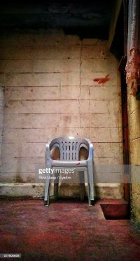 Old Plastic Chairs In Basement Stock Photo | Getty Images