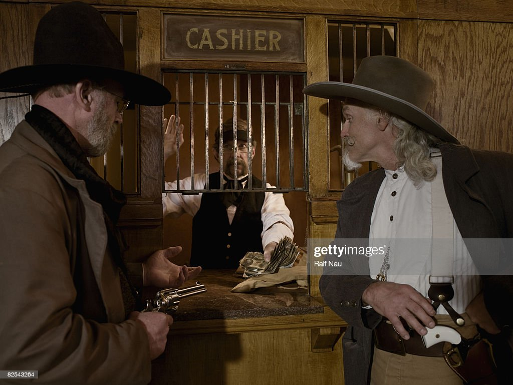 Oldfashioned Bank Robbers Holding Up Bank Teller Stock Photo Getty Images