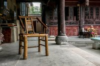 Old-styled bamboo chairs in a temple's teahouse. Every ...