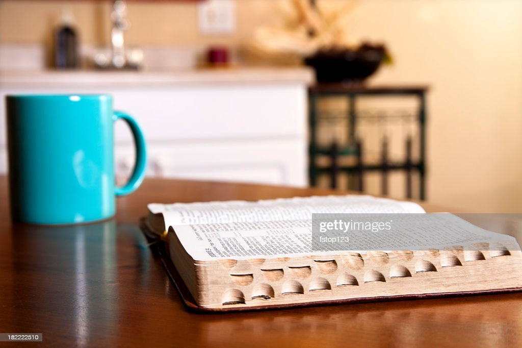 standard kitchen table size brushed nickel faucet with sprayer open bible on coffee mug stock photo ...