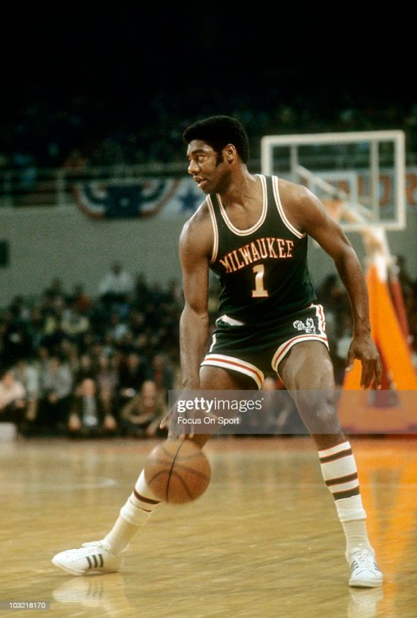 Oscar Robertson of the Milwaukee Bucks dribbles the ball