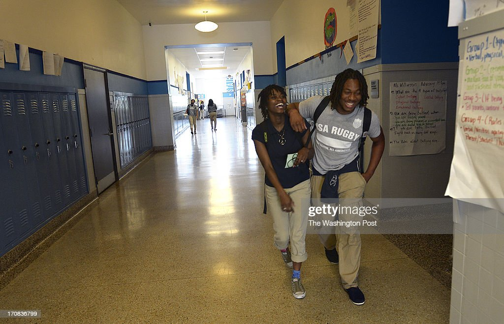 Perry street prep senior christian adams right walks through the school hallways with his best friend also excel academy charter stock photos and pictures rh gettyimages