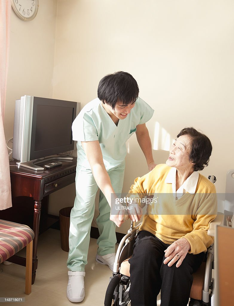 Personal Care Assistant And Senior Woman Stock Photo