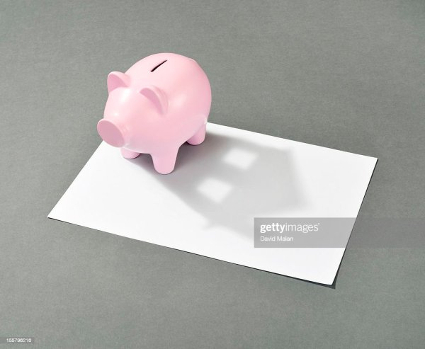 Piggy Bank With House Shaped Shadow Stock Getty