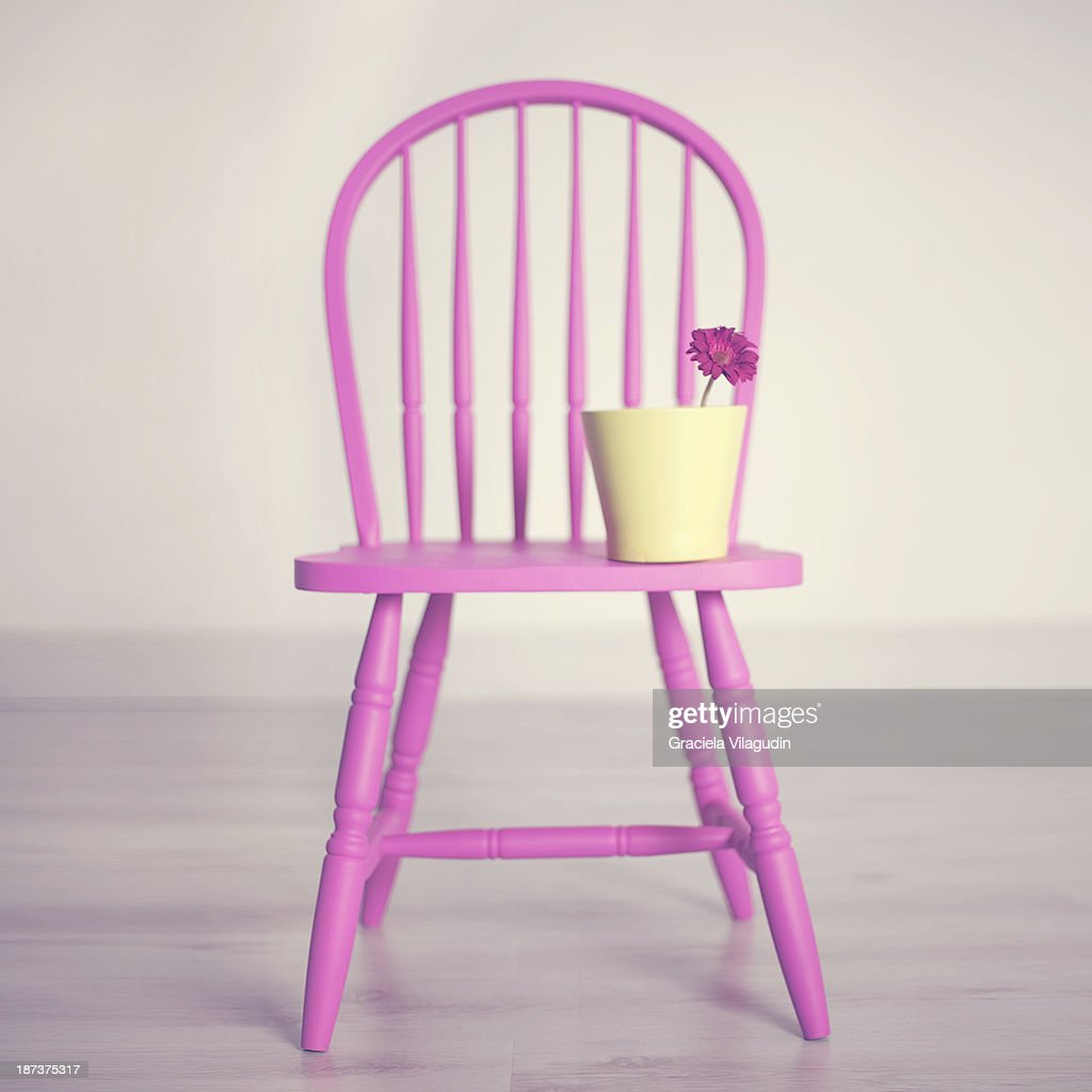 Pink Vintage Chair With Green Vase With Flower Stock Photo