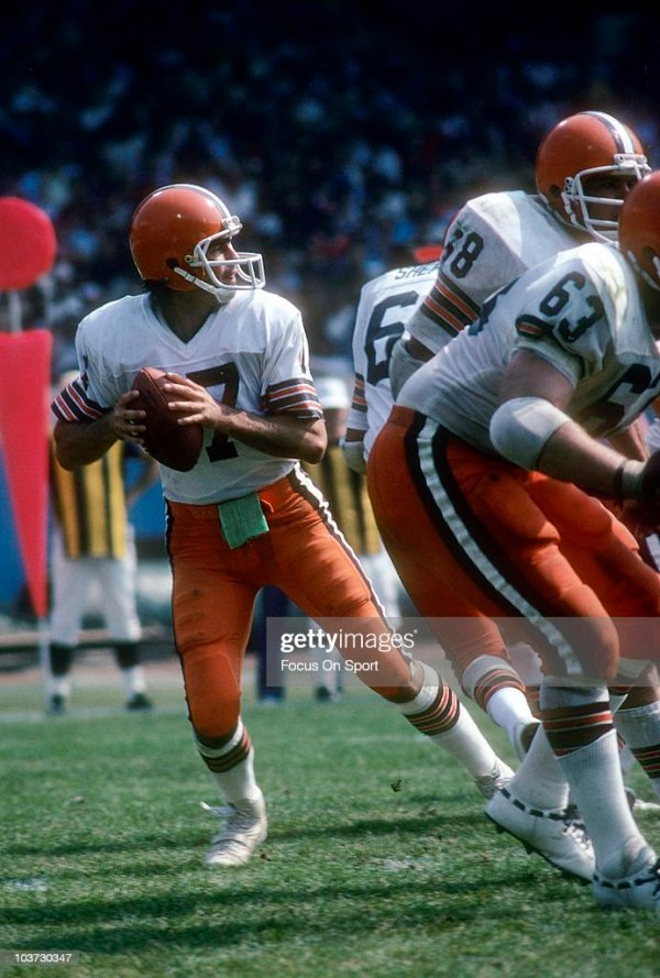 Quarterback Brian Sipe of the Cleveland Browns drops back