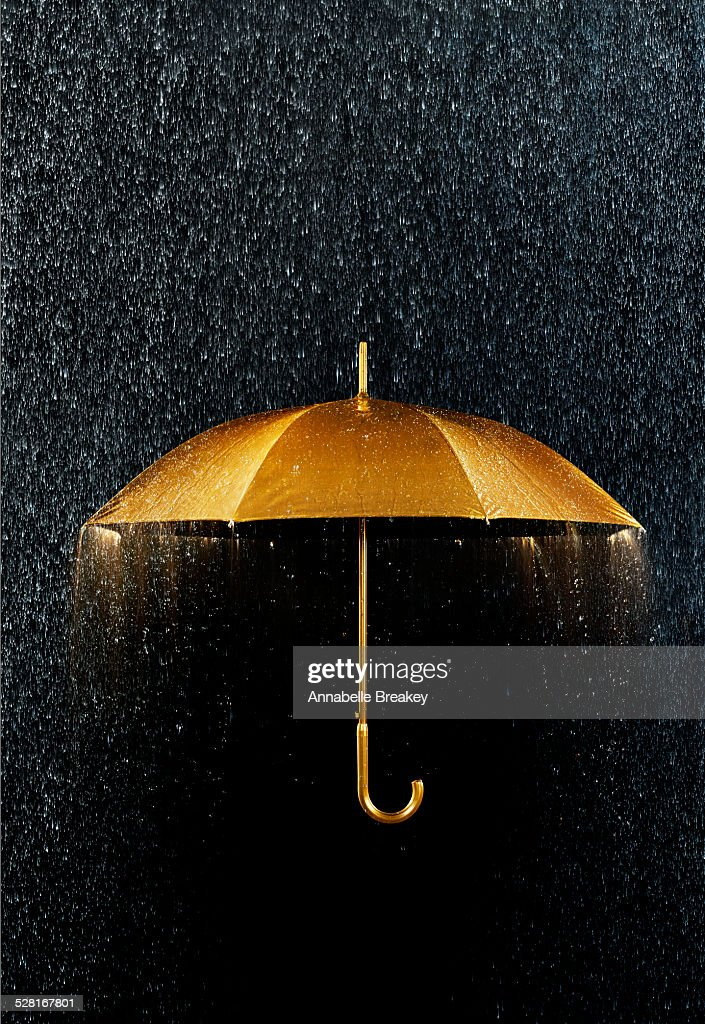 Rain With Gold Umbrella Stock Photo  Getty Images