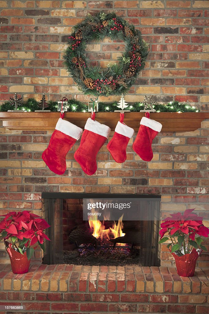 Close Up On Christmas Tree And Stocking Hanging On Fireplace Stock Christmas Stocking Stock Photos And Pictures | Getty Images
