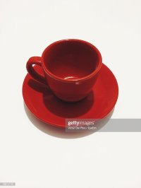 Red Tea Cup And Saucer Against White Background Stock ...