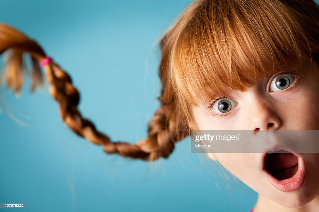 redhaired girl with upward braids
