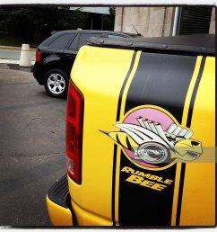 rumble bee logo on dodge ram stock photo [ 1024 x 1024 Pixel ]
