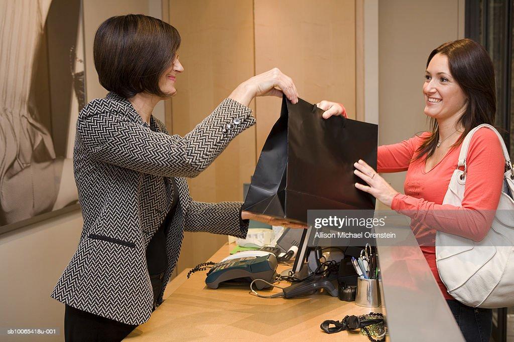 sales woman giving customer