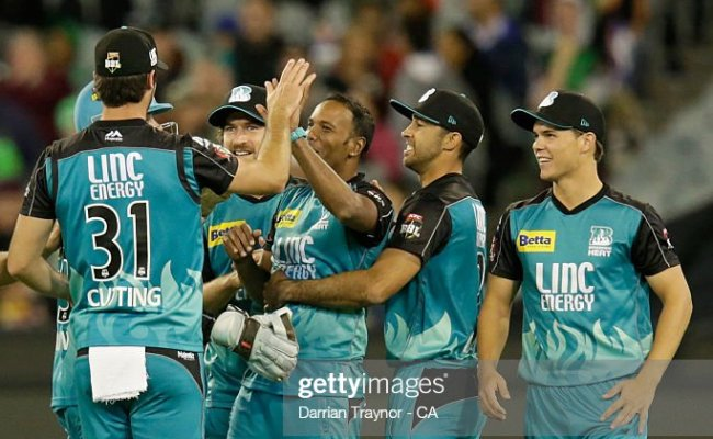 Samuel Badree Of The Brisbane Heat Is Congratulated By