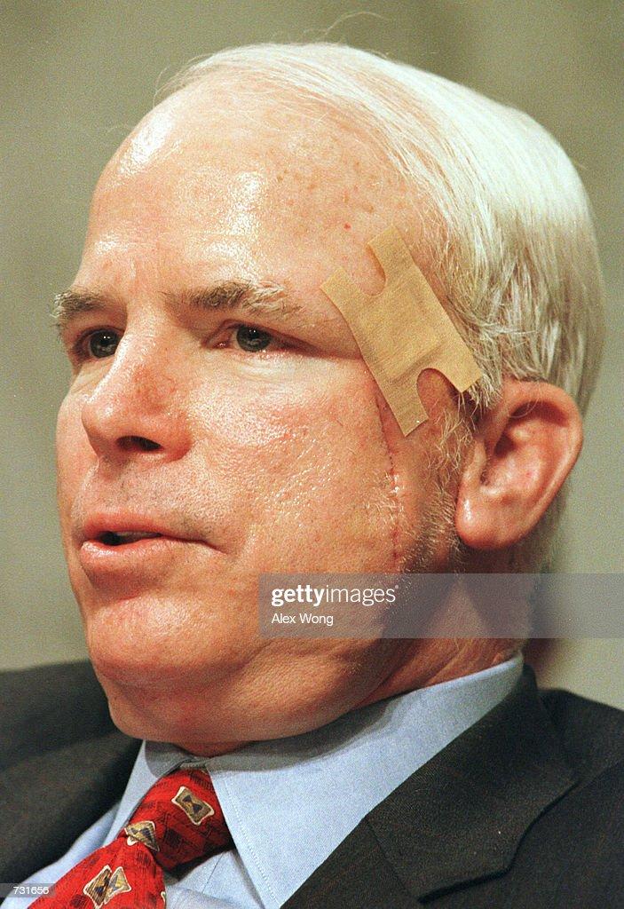 Sen John McCain with a facial scar and a bandage on his