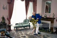 Senior Couple Dancing In Living Room Elevated View Stock