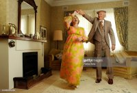 Senior Couple Dancing In Living Room Stock Photo