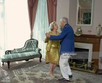 Senior Couple Dancing In Living Room Side View Stock Photo