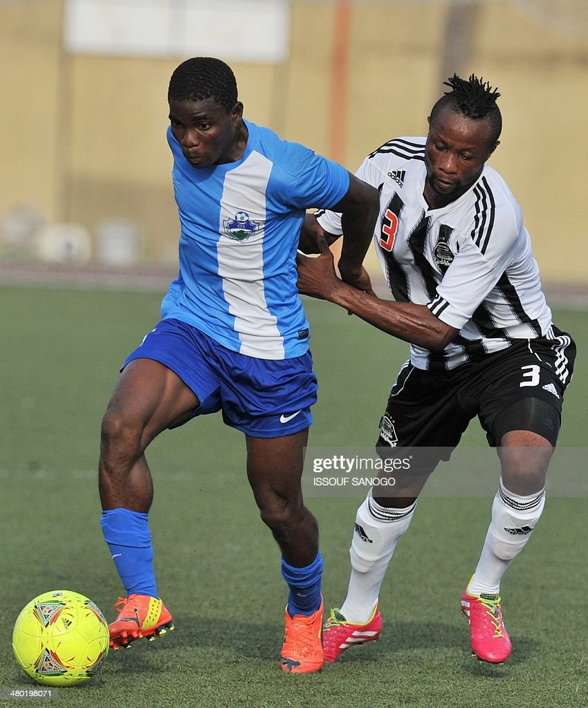 Sewe's Forward Roger Assale (l) Vies With Tp Mazembe's