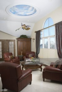 Sitting Area With Leather Club Chairs Arched Window With