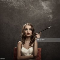 Cigarette Holder Stock Photos and Pictures | Getty Images
