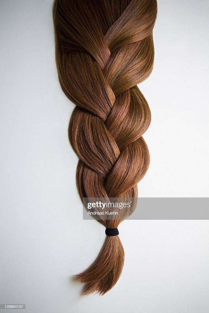 Still Life Of Red Haired Braid On White Background Stock