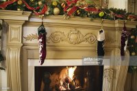 Stockings Hung On A Fireplace Stock Photo | Getty Images