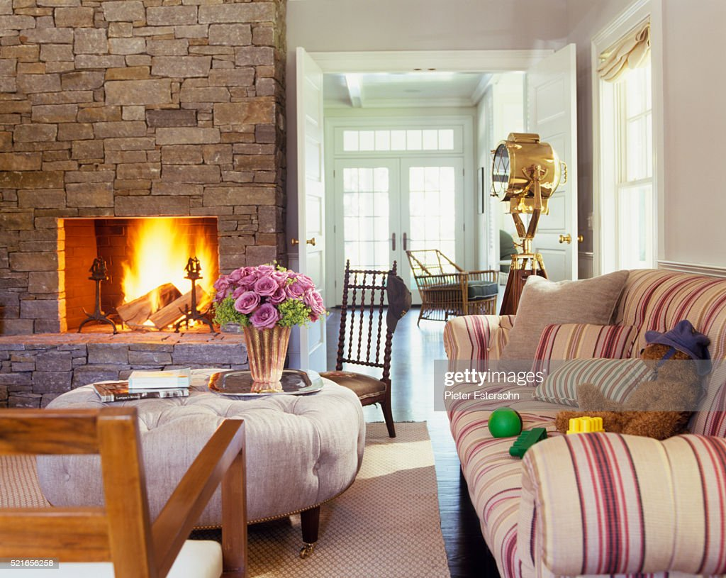 country living rooms with fireplaces small room tables stone fireplace in cozy stock photo getty images