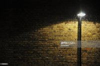 Street Lamp By Brick Wall At Night Stock Photo | Getty Images
