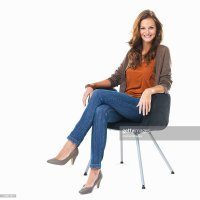 Studio Shot Of Young Woman Sitting In Chair Stock Photo ...