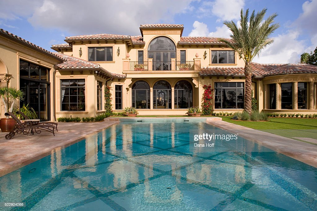 swimming pool and patio by spanish style house high res stock photo getty images