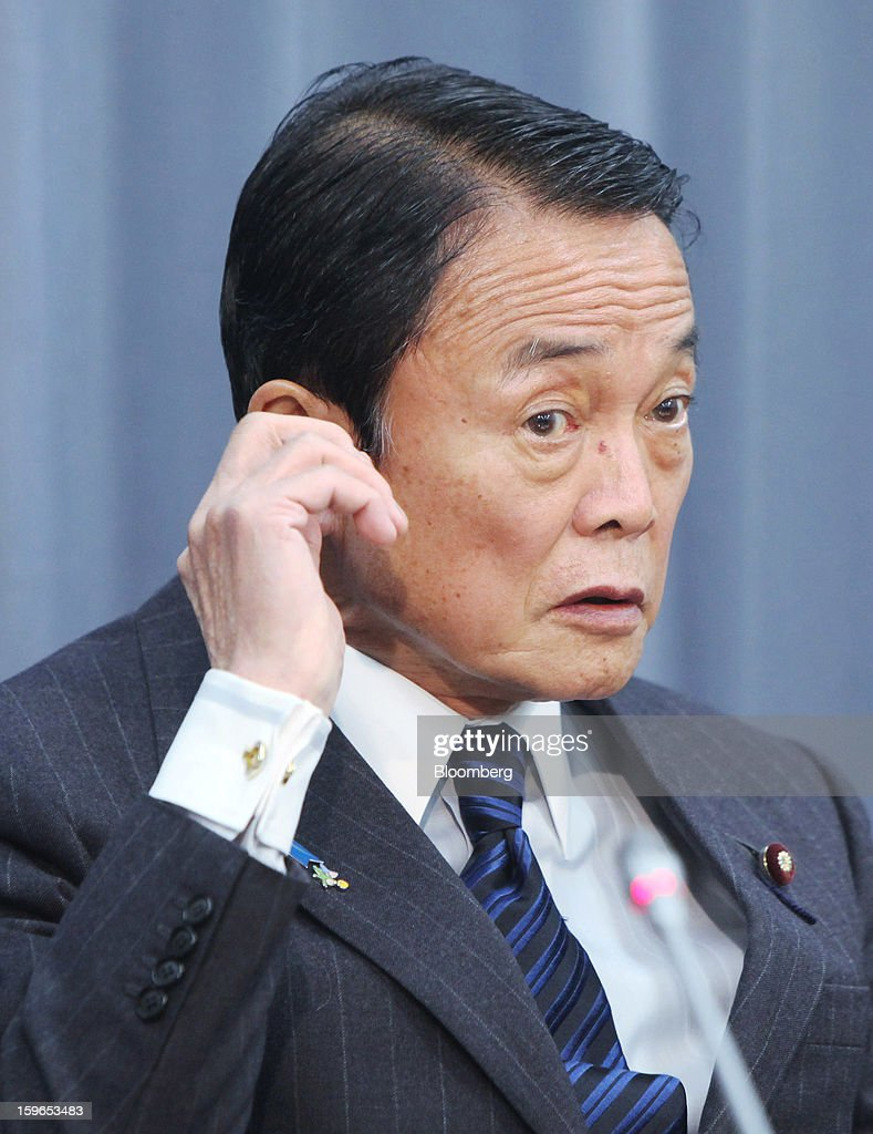 Taro Aso. Japan's deputy prime minister and finance minister. listens... News Photo - Getty Images