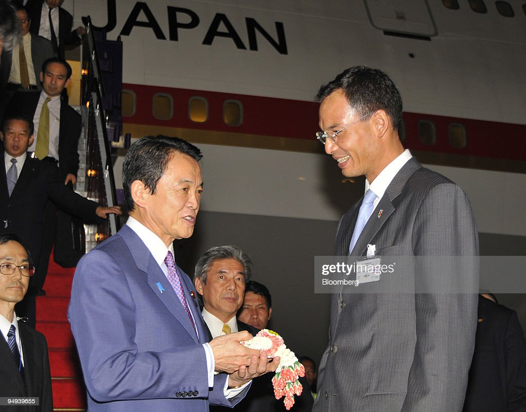Taro Aso. Japan's prime minister. left. is welcomed by Korn... News Photo - Getty Images
