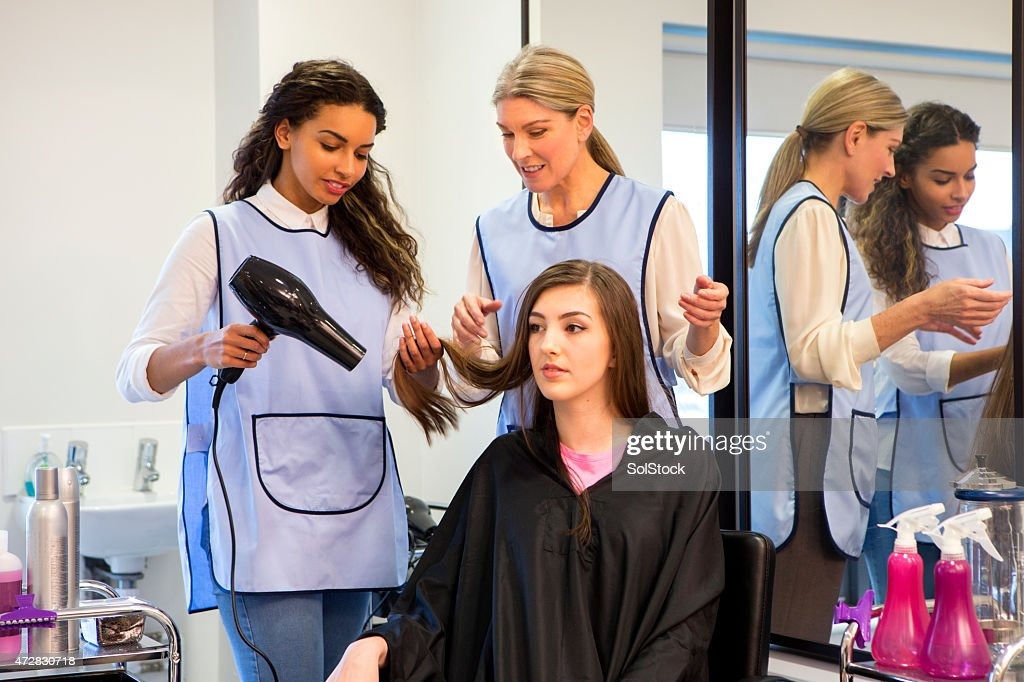 Teacher Helping Student Training To Become Hairdressers