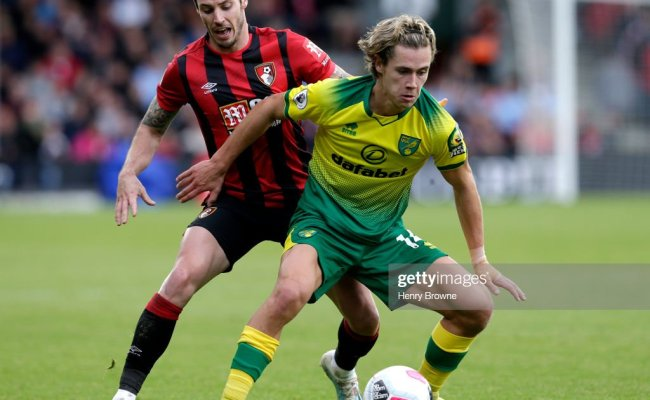 Todd Cantwell Of Norwich City Is Challenged By Adam Smith