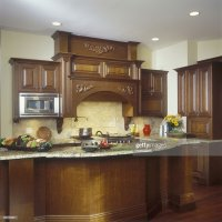 Traditional Upscale Kitchen With Dark Wood Cabinets Stock ...