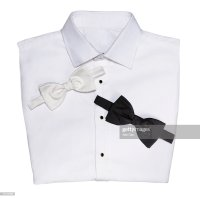 Tuxedo Shirt Folded With Black And White Bow Tie Over Head ...