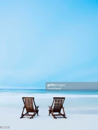 Two Beach Chairs On Tropical Beach At Sunrise Stock Photo ...