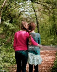 Two Girls With Hair Braided Together Stock Photo | Getty ...