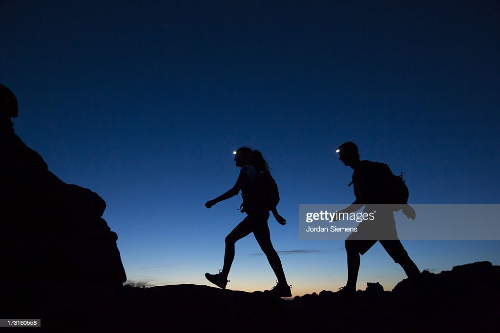 Two People Hiking At Night Stock Photo - Getty Images