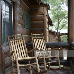 Affordable Rocking Chairs Desk Chair Slipcover Two Wood On Log Cabin Porch Stock Photo | Thinkstock