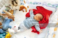 Twoweeks Old Baby Boy In Playpen Stock Photo